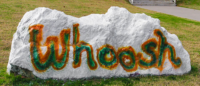 The word 'Whoosh' painted on the UTD spirit rock.